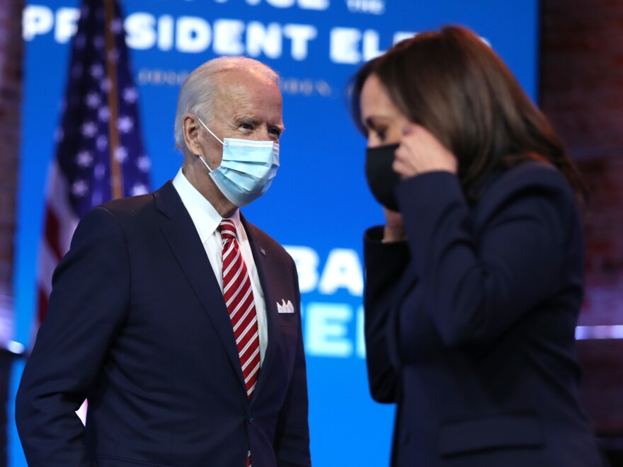 President-elect Joe Biden walks by Vice President-elect Kamala Harris before delivering remarks on his plan for economic recovery under his administration.