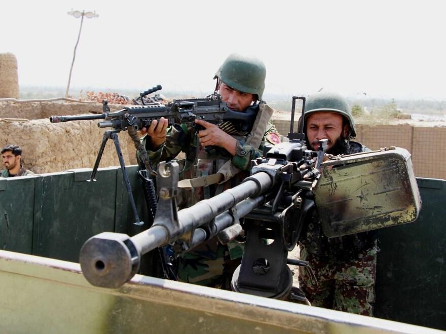 Afghan soldiers fight Taliban militants in Kunduz province, Afghanistan, on Sept. 21.