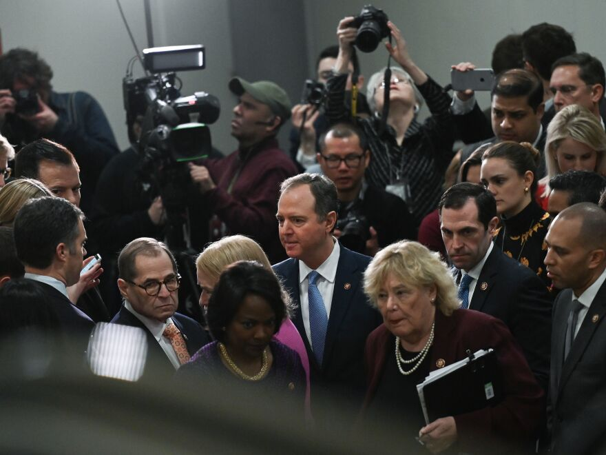 House Manager Adam Schiff (center) leaves after speaking to reporters during the Senate impeachment trial of President Trump Friday.