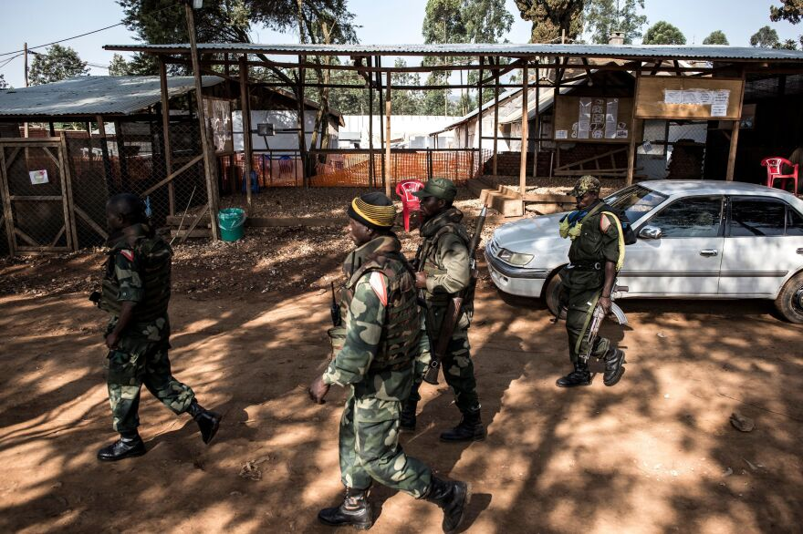 Soldiers from the Armed Forces of Democratic Republic of the Congo outside an Ebola Treatment Center in Butembo.