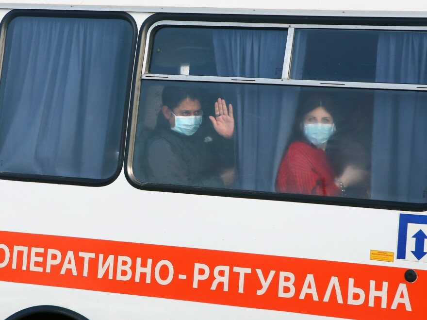 Evacuated Ukrainians and foreign nationals travel to the Novi Sanzhary Medical Center of the National Guard in Poltava Region for medical observation on Thursday.
