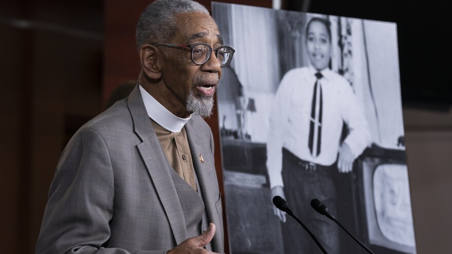 Rep. Bobby Rush, D-Ill., speaks during a news conference about the Emmett Till Antilynching Act on Wednesday on Capitol Hill. He stands beside a photo of Emmett Till, a 14-year-old African American who was lynched in Mississippi in the 1950s.