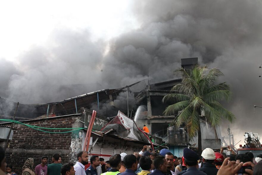 Firefighters try to extinguish the fire at a packaging factory in the industrial zone of Tongi on Saturday.