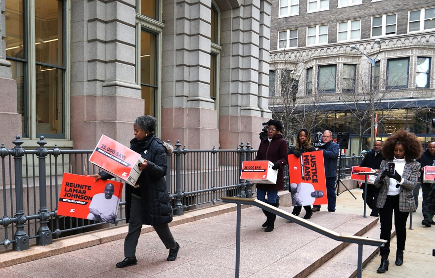 Jamala Rogers, far left, the executive director of the Organization for Black Struggle, helps deliver petitions supporting a new trial for Lamar Johnson to Attorney General Eric Schmitt on Dec. 10, 2019.