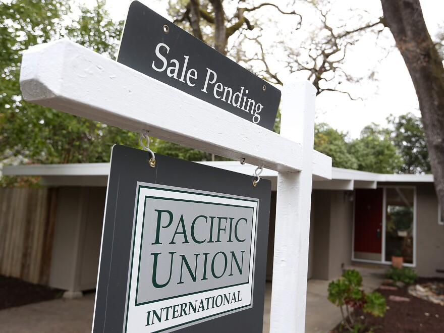 A sale-pending sign is posted in front of a home last month in San Anselmo, Calif.