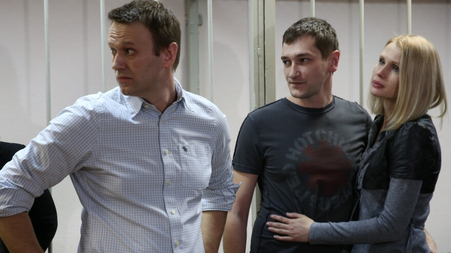 Russian opposition leader Alexey Navalny (left) and his brother Oleg Navalny appear in Moscow for sentencing last month after their conviction for fraud. Alexey was given a 3 1/2-year suspended sentence. His brother was sent to prison for the same period.