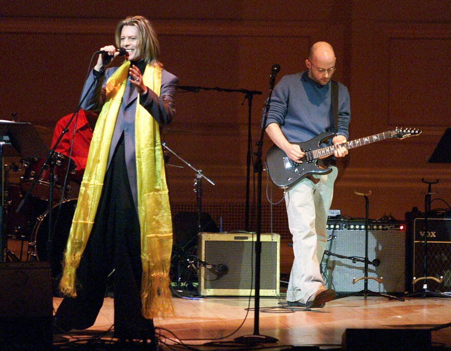Moby (with guitar) performs with David Bowie at the Tibet House Benefit Concert in 2001.