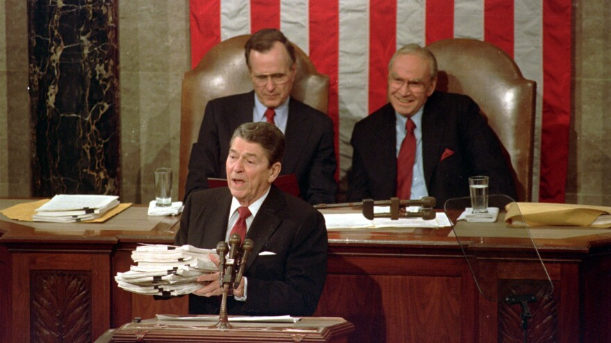 Wright (right), then House speaker, is seated behind President Reagan and next to Vice President George H.W. Bush during the 1988 State of the Union address.