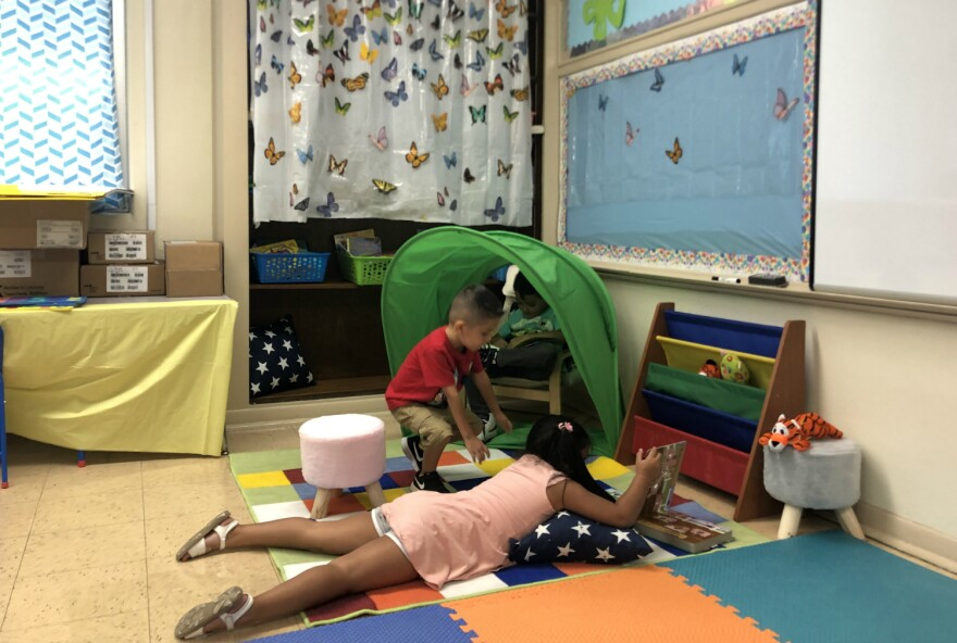 Students explore books in a nook of the bilingual kindergarten class at Athens Elementary on Aug. 21, 2019.