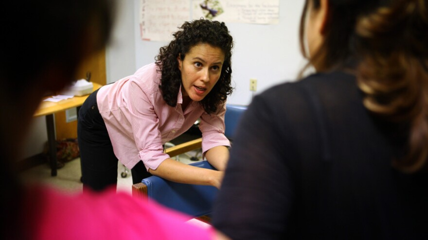 Midwife Ana Luisa Ralston talks with Rosa Lainez (right) and Andrea Lopez about issues related to their upcoming deliveries during the Group Prenatal Care class at the Upper Cardozo Health Center in Washington. Here, Ralston demonstrates a position to assume during labor.