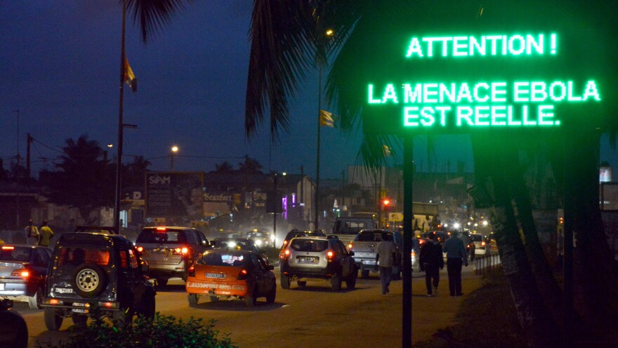 "A sign in Abidjan, Ivory Coast's capital, warns residents that ""the Ebola threat is real."""
