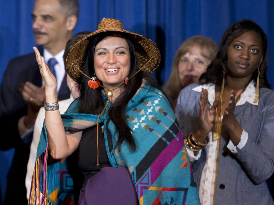Deborah Parker, vice chair of the Tulalip Tribes of Washington state, reacts to President Barack Obama signing the Violence Against Women Act in 2013 in Washington.
