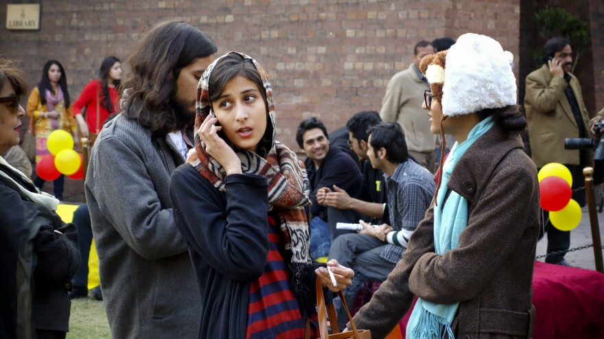 Students stand in long lines outside lecture halls during the three-day long Lahore Literary Festival.