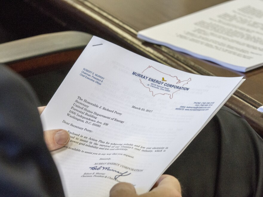 """A photo obtained by The Associated Press shows the cover sheet of a confidential """"action plan"""" brought by Robert Murray, of Murray Energy, to a meeting at the Department of Energy headquarters in Washington, D.C."""