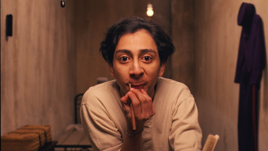 Actor Tony Revolori, who plays Zero Moustafa in <em>The Grand Budapest Hotel,</em> paints on a mustache. The movie was full of fake mustaches — but most were made of human hair and silk, rather than paint.