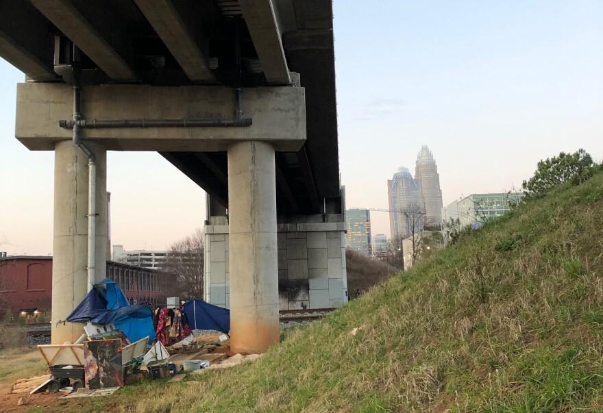 homeless camp under bridge