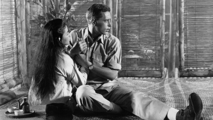 Actors John Kerr and France Nuyen in a scene from the 1958 film <em>South Pacific</em>. The interracial romance between the onstage pair unsettled some audiences.