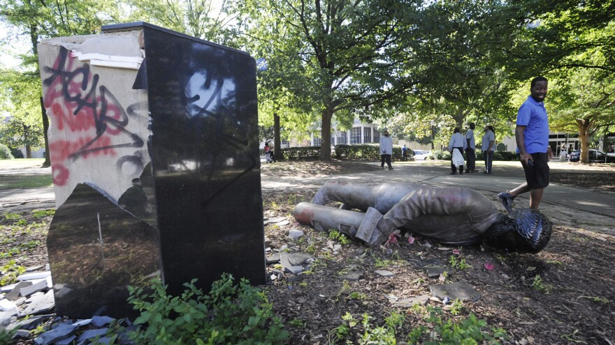 A statue of Charles Linn, a onetime Confederate officer and a founder of Birmingham, sits toppled Monday. The statue fell after unrest in Birmingham following George Floyd's death.