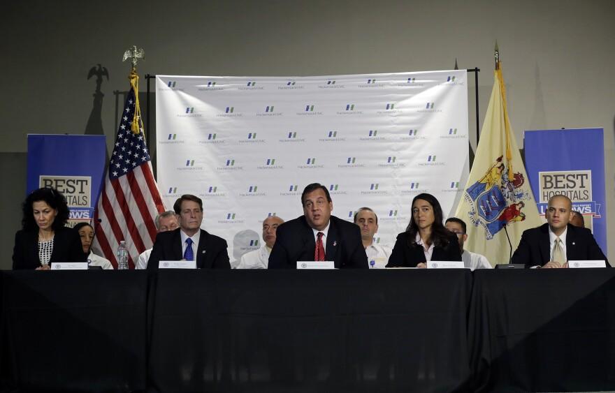 New Jersey Governor Chris Christie, center, addressed a gathering on Ebola preparedness last month at Hackensack University Medical Center.