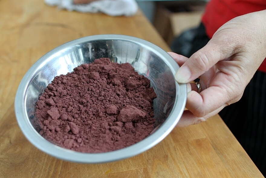Klemek holds a small dish of cabernet wine flour she uses in her brownies and pasta.