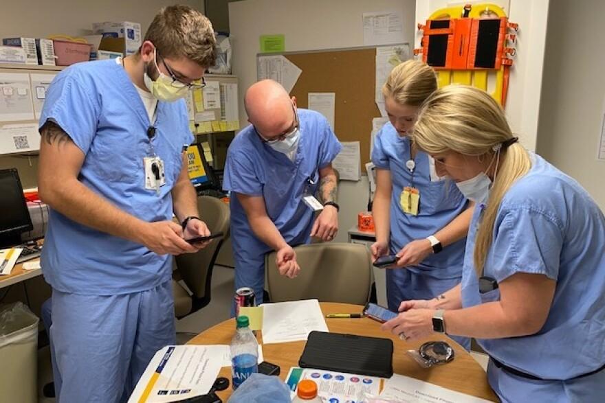 Healthcare providers in the WVU Medicine J.W. Ruby Memorial Hospital Emergency Department receive their digital PPE from RNI team members.