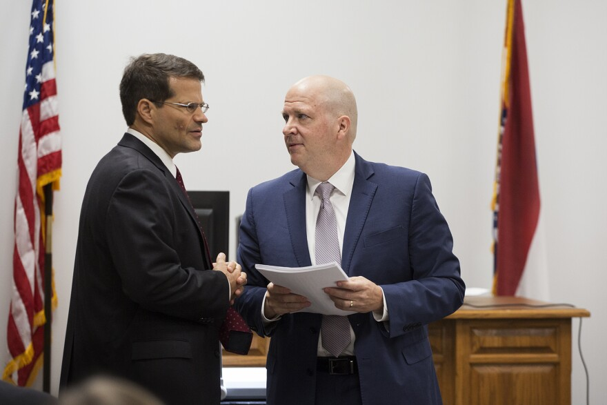 Missouri Solicitor General John Sauer, left, and Planned Parenthood attorney Chuck Hatfield speak during a break on the first day of a hearing that could determine the fate of Missouri's sole abortion clinic. Oct. 28, 2019