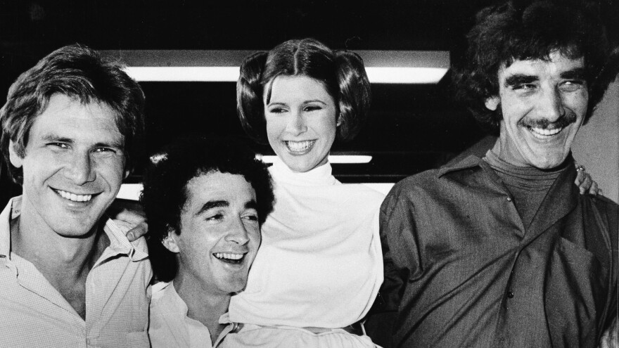 In 1978, <em>Star Wars</em> actors (from left) Harrison Ford, Anthony Daniels, Carrie Fisher and Peter Mayhew.