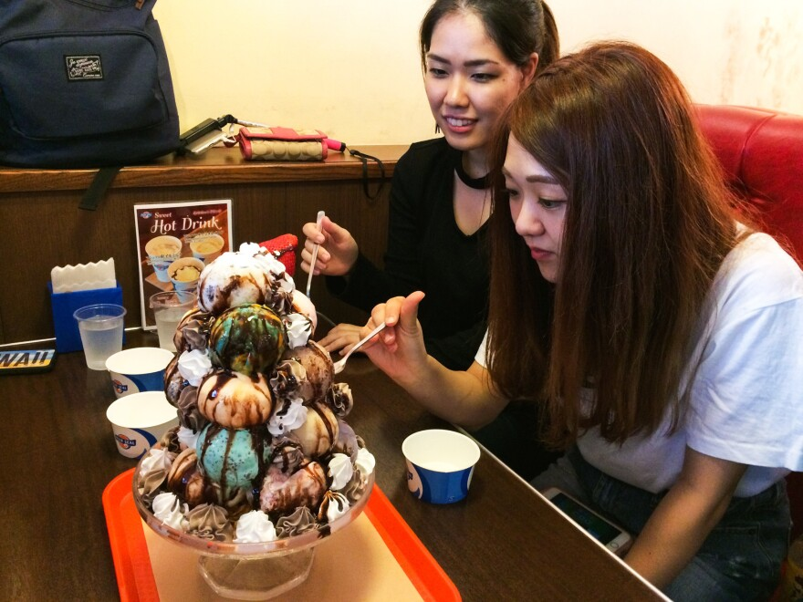Two Okinawan college students dig into their 17-scoop ice cream treat.