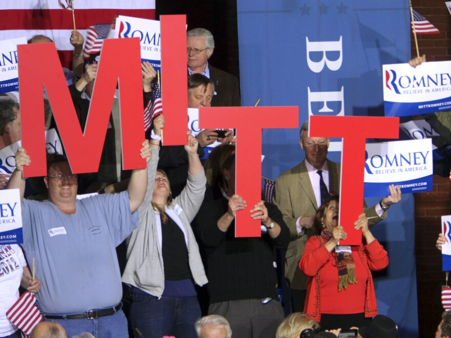 Supporters of Republican presidential candidate Mitt Romney cheer as they wait for his arrival April 24 in Manchester, N.H.