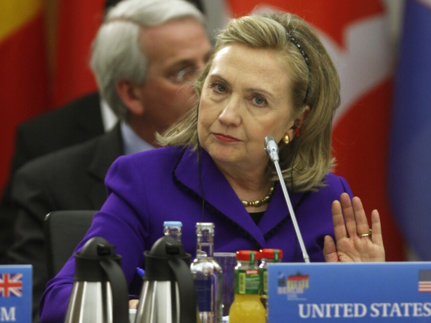 U.S. Secretary of State Hillary Clinton said regime change in Libya is outside NATO's military mandate during a meeting of NATO foreign ministers Thursday in Berlin.