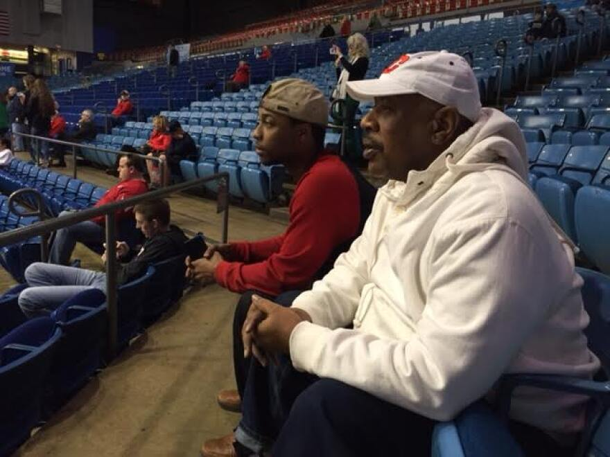 Longtime Flyer fan Steven Easterling of Dayton and his son watch the flyer's first practice in the NCAA tournament