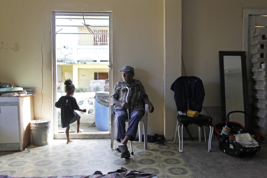 Gregorio Velazquez Rivera, 81, sits inside an abandoned house he now occupies with his relatives after they lost their home to Hurricane Maria in Vieques, Puerto Rico.