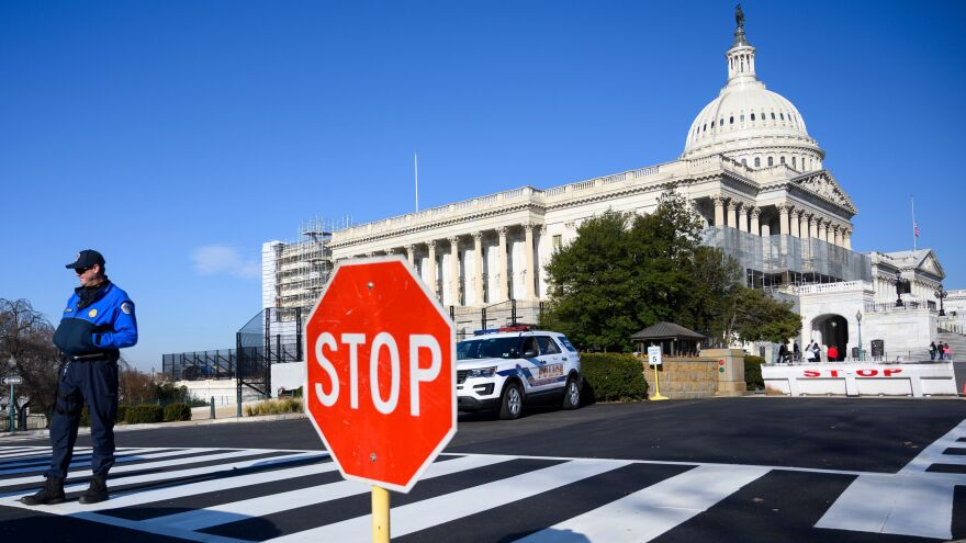 A police officer stands near the U.S. Capitol during a partial government shutdown in Washington, D.C., on Thursday.