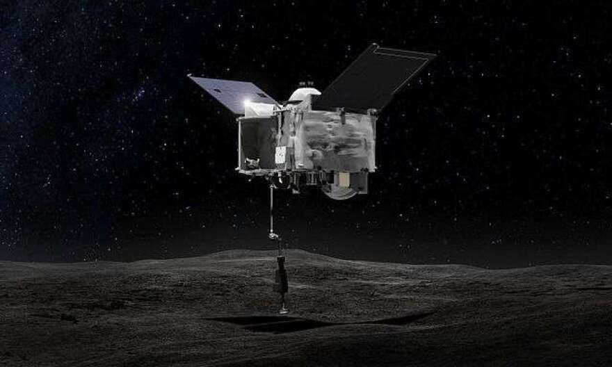 This artist's concept shows OSIRIS-REx spacecraft contacting the asteroid Bennu with the Touch-And-Go Sample Arm Mechanism or TAGSAM. Photo: NASA