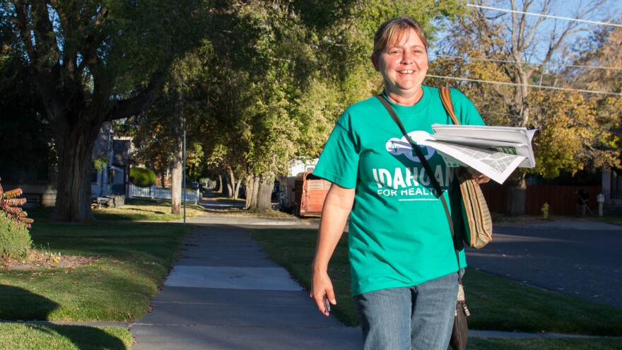 Amy Pratt, a volunteer for Reclaim Idaho, gathers signatures by going door-to-door in Idaho Falls in October 2018 to encourage voters to expand Medicaid eligibility in Idaho. Social distancing measures are making the kind of campaigning needed for ballot measures nearly impossible.
