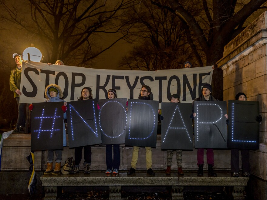 Hundreds of New Yorkers gathered at Columbus Circle in New York for a protest march to Trump Tower after the president signed an order to advance the Keystone XL and Dakota Access pipelines.