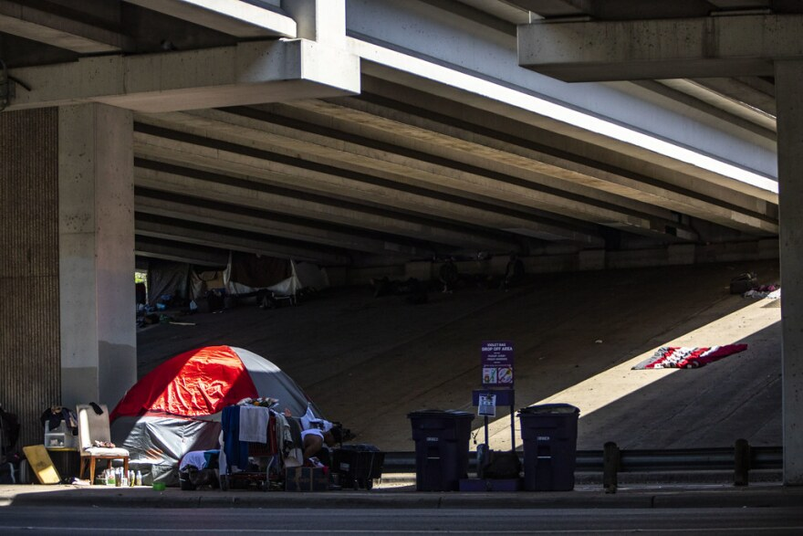 An encampment of people experiencing homelessness under SH 71 in South Austin