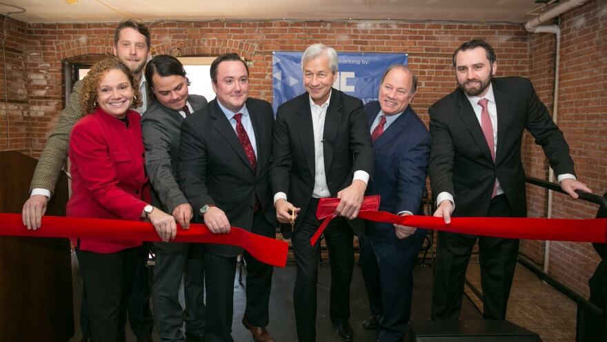 Detroit Mayor Mike Duggan, second from right, and developers attend a ribbon cutting in Detroit's West Village neighborhood in 2016.