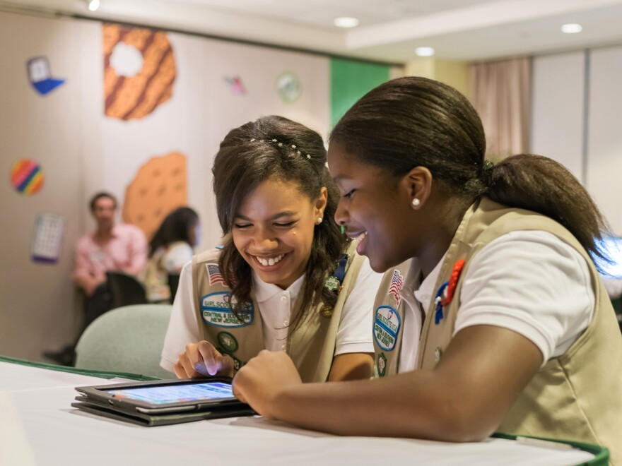 In this undated photo released by the Girl Scouts of the USA, Girl Scouts Bria and Shirell practice selling cookies on one of two new digital platforms. It's the first time the organization has allowed the sales of cookies using a mobile app or personalized websites.