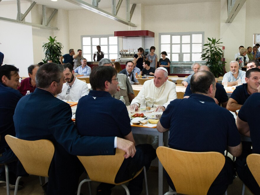 In this photo provided by the Vatican newspaper <em>L'Osservatore Romano</em>, Pope Francis has lunch at the Vatican workers' cafeteria on Friday.
