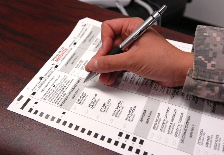 A voter filling in a ballot.
