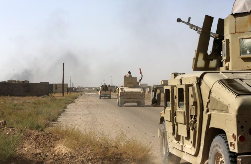 Iraqi forces advance in Fallujah, Iraq on Wednesday.