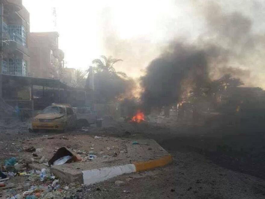 Smoke rises frome the scene of a car bomb attack in Kadhimiya, Baghdad, Iraq, on Saturday.