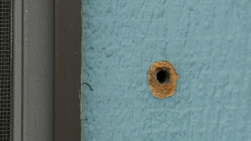 A bullet hole is seen in an exterior wall at the Rancho Tehama Elementary School on Nov. 15, 2017. Gunman Kevin Janson Neal is believed to have spent six minutes shooting into the school before driving off to continue his shooting spree. One student was wounded by gunfire and a second by flying glass.