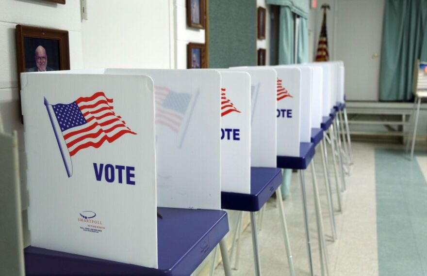 Voting booths set up and ready to receive voters inside a polling station in Florida in 2016. (Gregg Newton/AFP/Getty Images)