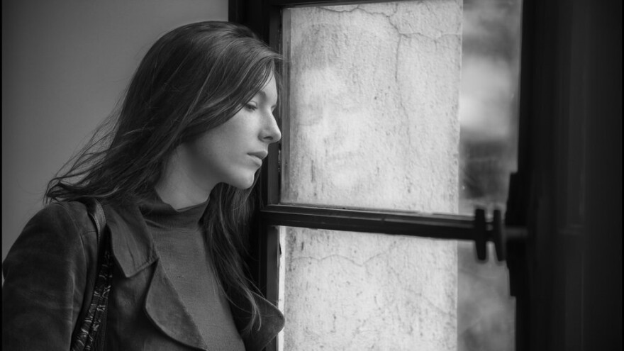 Ariane (Louise Chevillotte) gazes winsomely out a window like the Parisian university student she is, in <em>Lover for a Day</em>.