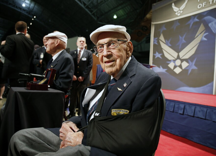 """Retired U.S. Air Force Lt. Col. Richard """"Dick"""" Cole in 2015 after being presented with a Congressional Gold Medal honoring him for his part in the Doolittle Raid during WWII, at Wright-Patterson Air Force Base in Dayton, Ohio."""