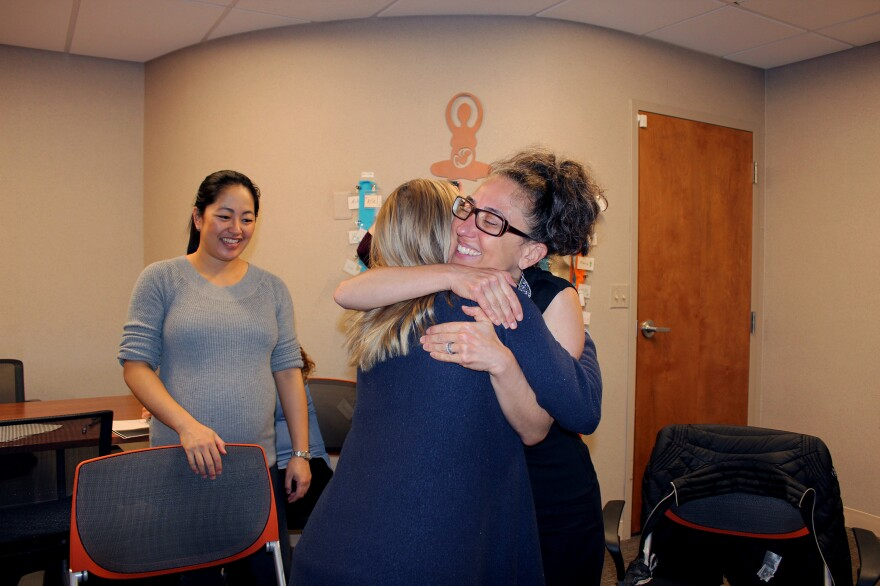 Midwife Ariel Yellin Derringer (right) hugs Grace Tuman at a session of CenteringPregnancy at Northwestern Medicine, as Sara Choh looks on.