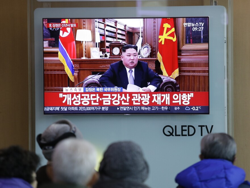 People at a railway station in Seoul, South Korea, watch a TV screen showing North Korean leader Kim Jong Un delivering his New Year's speech on Tuesday.