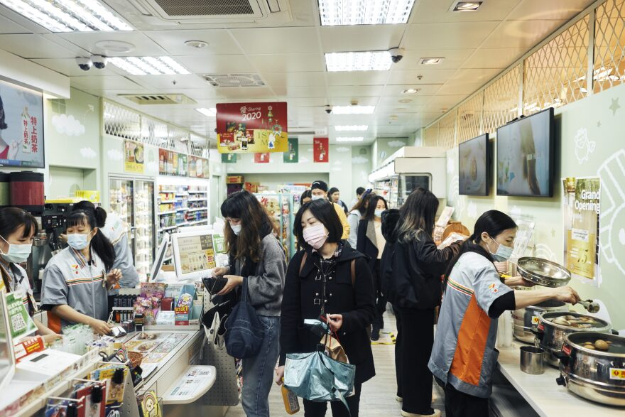 Customers wear face masks inside a store on Dec. 2, 2020, in Taipei, Taiwan. Taiwan imposed mandatory mask-wearing regulations in some circumstances, including on transport services and in markets and restaurants, as it tries to keep its record of controlling COVID-19 infections in check. (An Rong Xu/Getty Images)